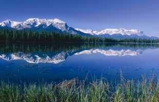 Beautiful Rocky Mountain range reflecting in a lake