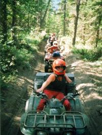 A group off-roading on ATVs